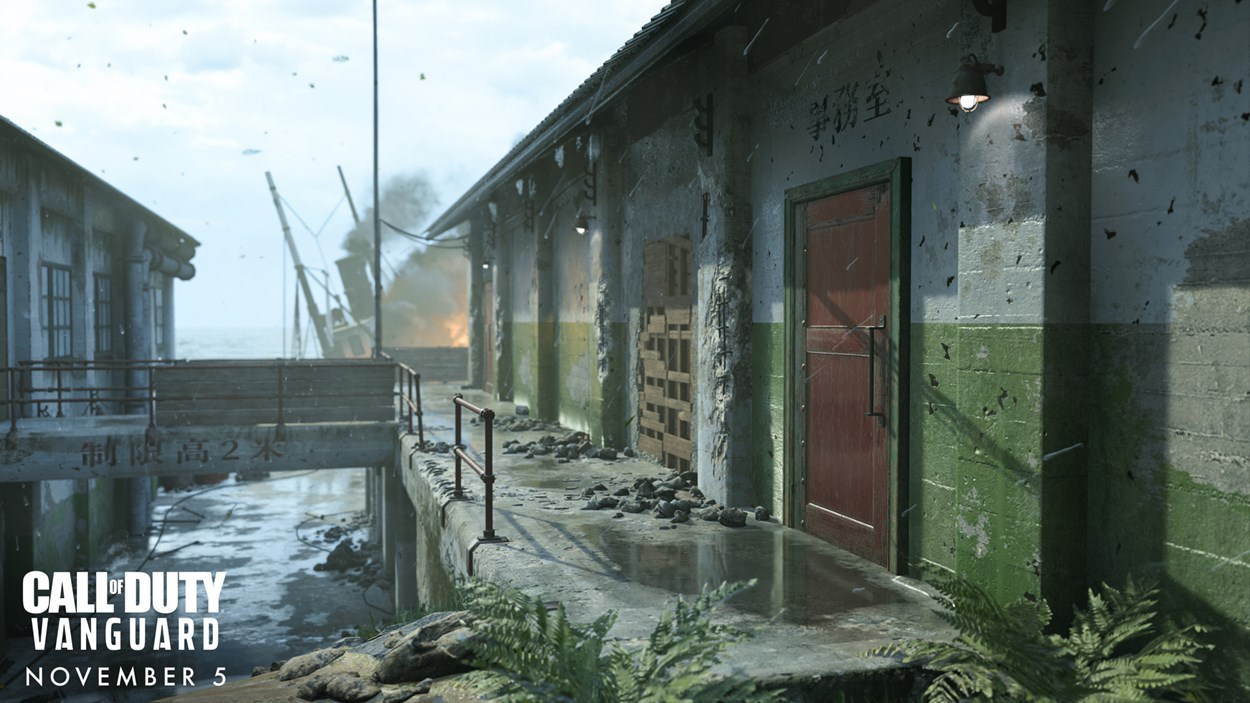 Buildings over a waterway with a burning ship in the background from Call of Duty - Vanguard