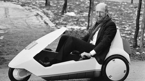 Sir Clive Sinclair and the Sinclair C5 electric vehicle.