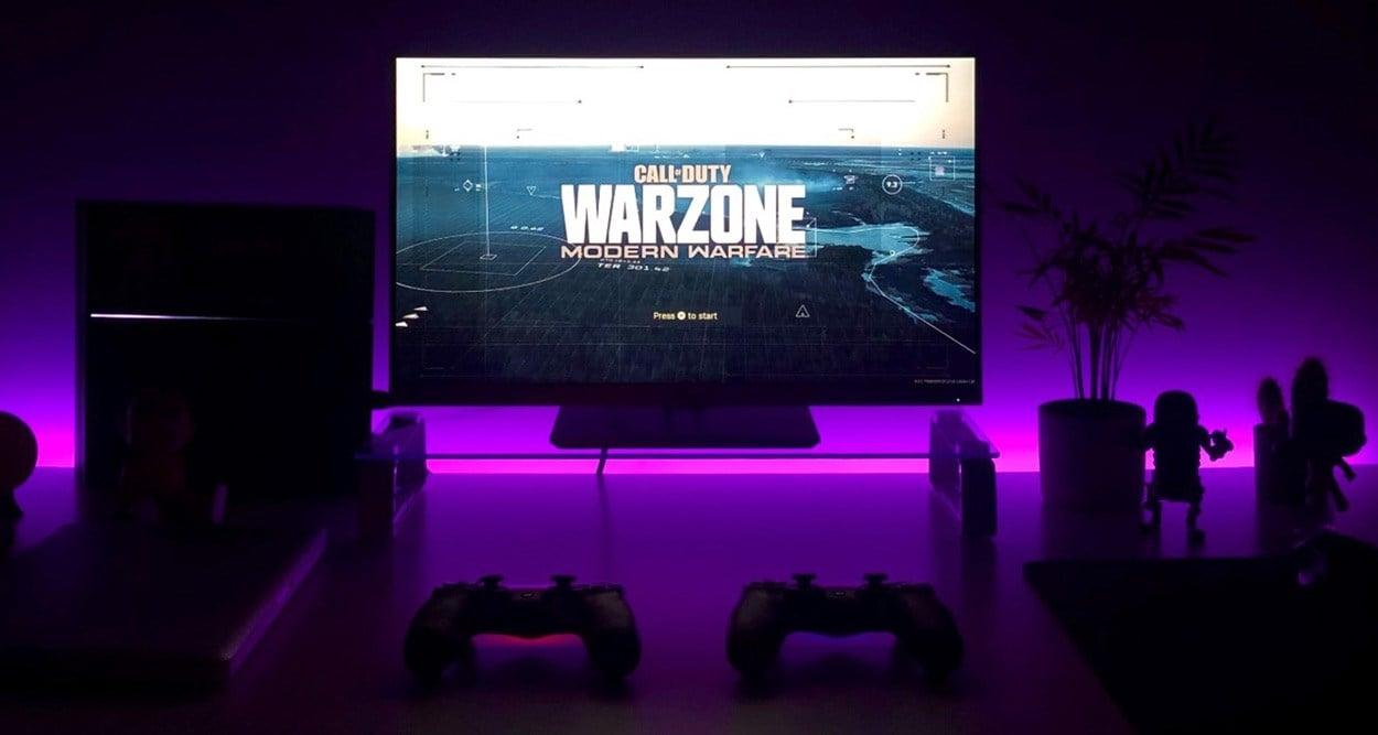 Purple RGB lit gaming PC with Warzone Modern Warfare loading screen.
