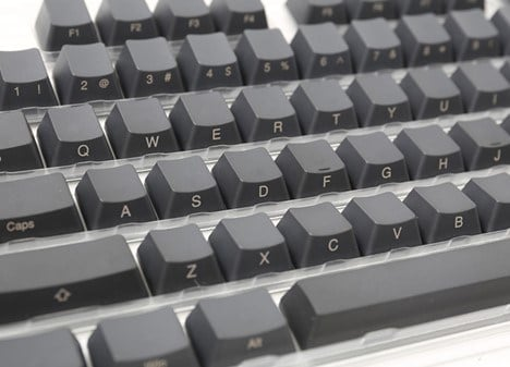 Close-up of Ducky's grey keycaps with the engraving on the sides instead of on top.