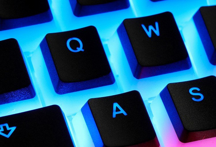 Close-up of Ducky's 'Pudding' keycaps, with a large amount of lighting.